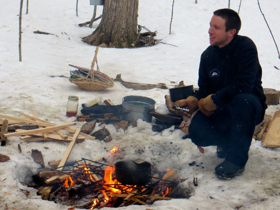 Heating maple syrup for sugar on snow