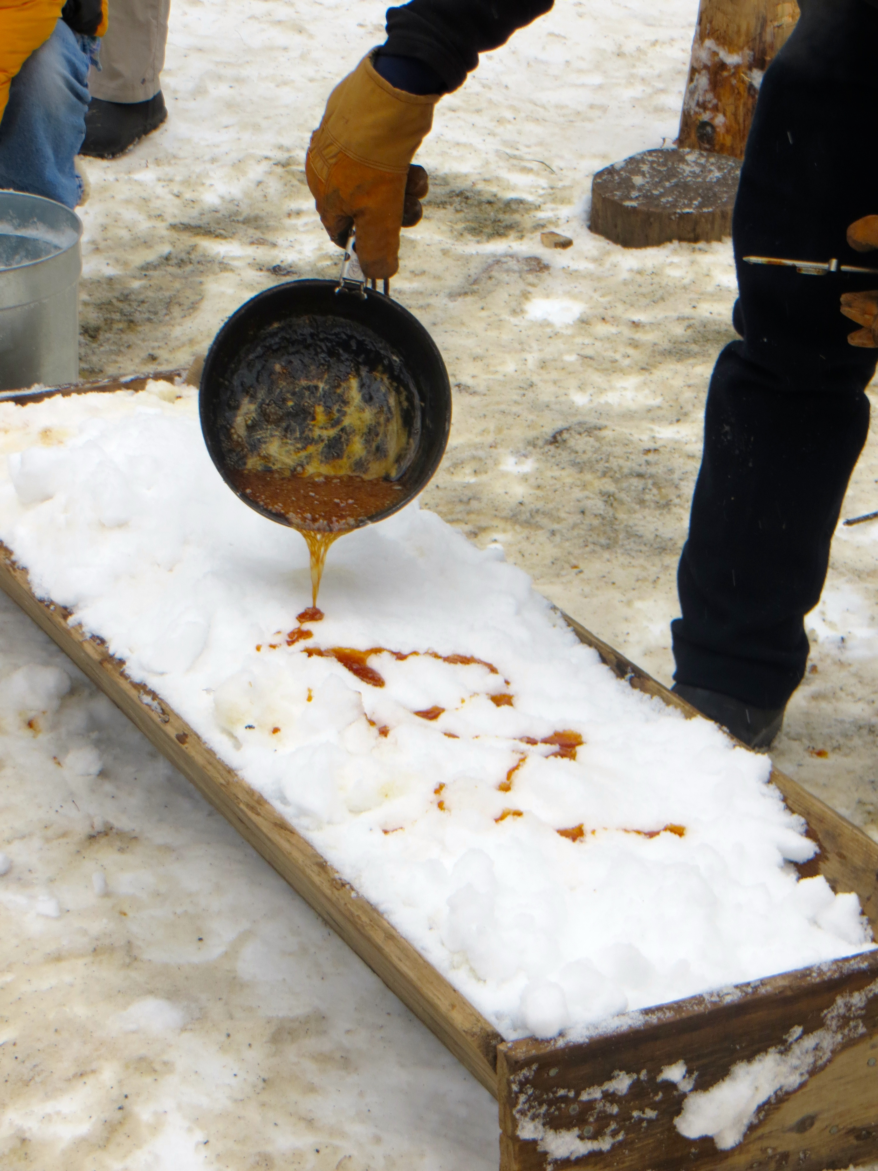 Pouring the hot syrup onto fresh snow